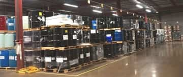 ADLI Logistic's warehouse with drums filled with chemicals.