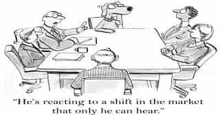 A cartoon of a dog and a few humans sitting at a table.